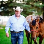 trainer leading horse